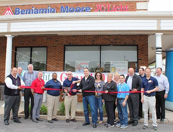 Bensenville Village President Frank DeSimone and JC Licht CEO Elliot Greenberg cut the celebratory red ribbon at the company store at 1047 S. York Road, Bensenville. They are joined by family members, village trustees, JC Licht employees and members of the Bensenville Chamber of Commerce.