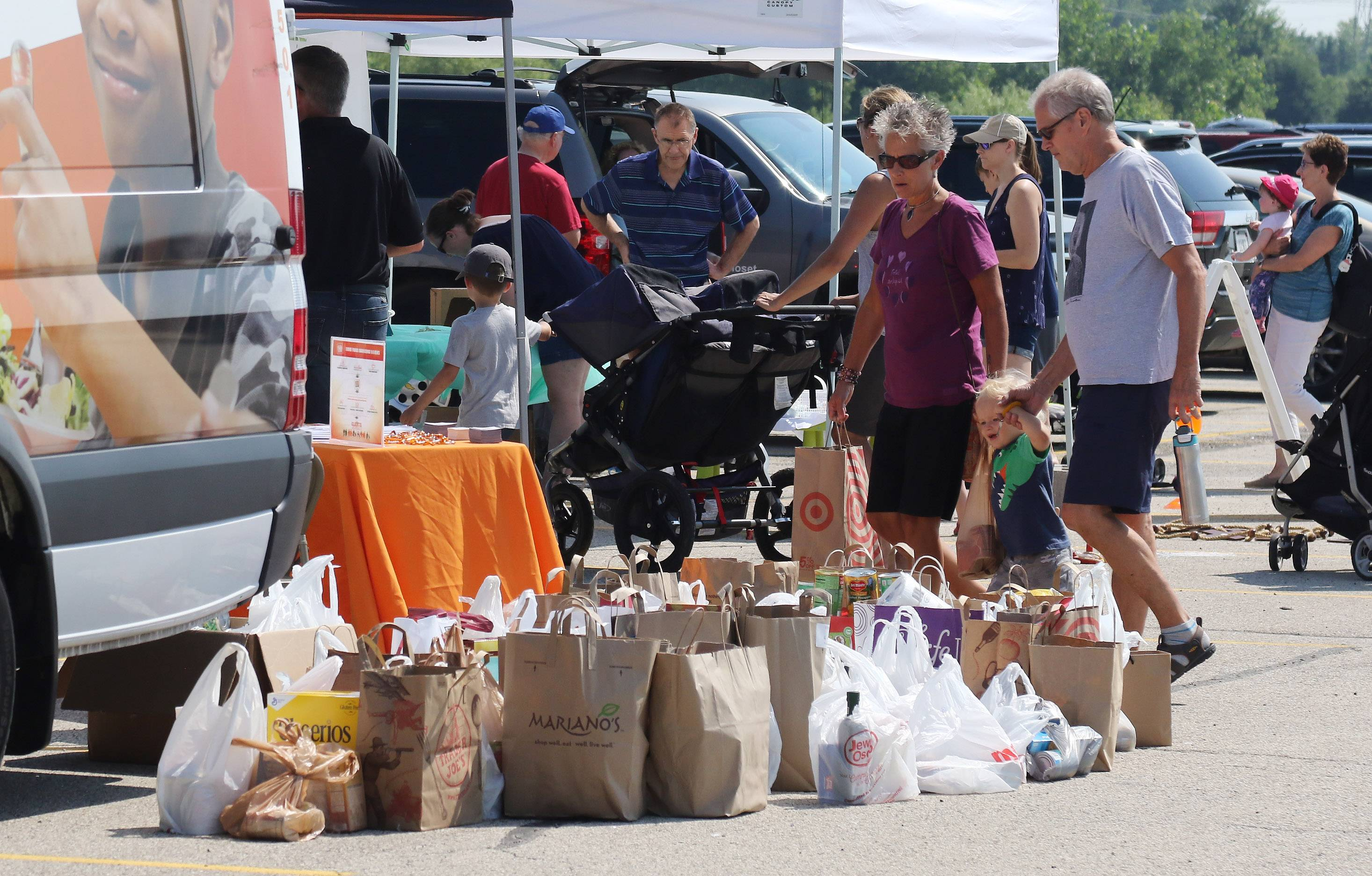 Big trucks attract lots of interest, food donations