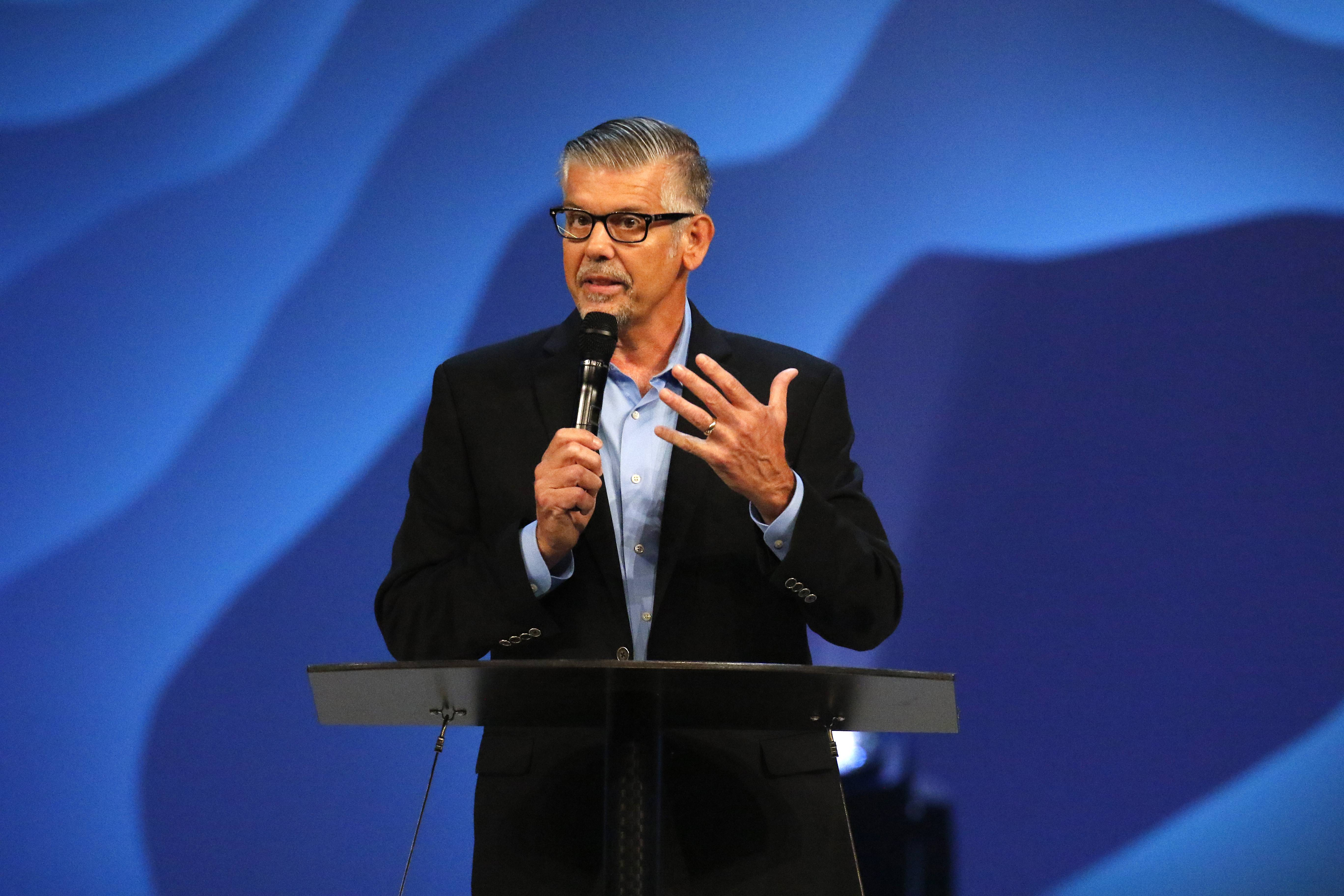 Tom De Vries, president and CEO of the Willow Creek Association, speaks to the crowd as Willow Creek hosts its 23rd annual Global Leadership Summit Thursday in South Barrington.
