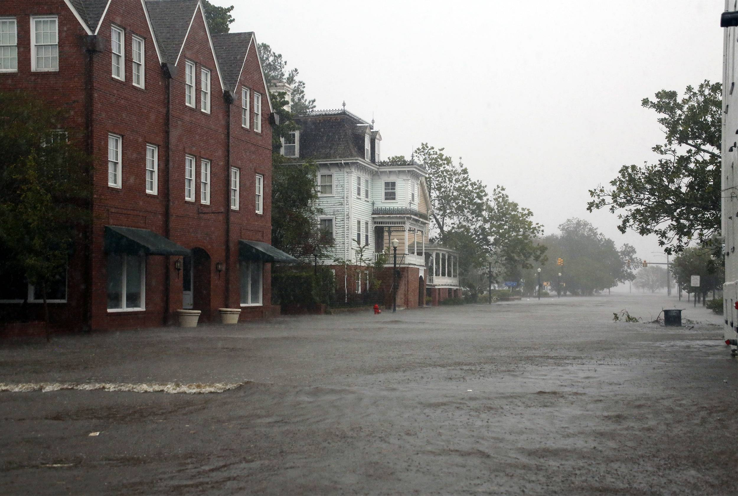 Flooding caused by Hurricane Florence covers blocks of Front Street in downtown New Bern, N.C.,  Friday, Sept. 14, 2018.