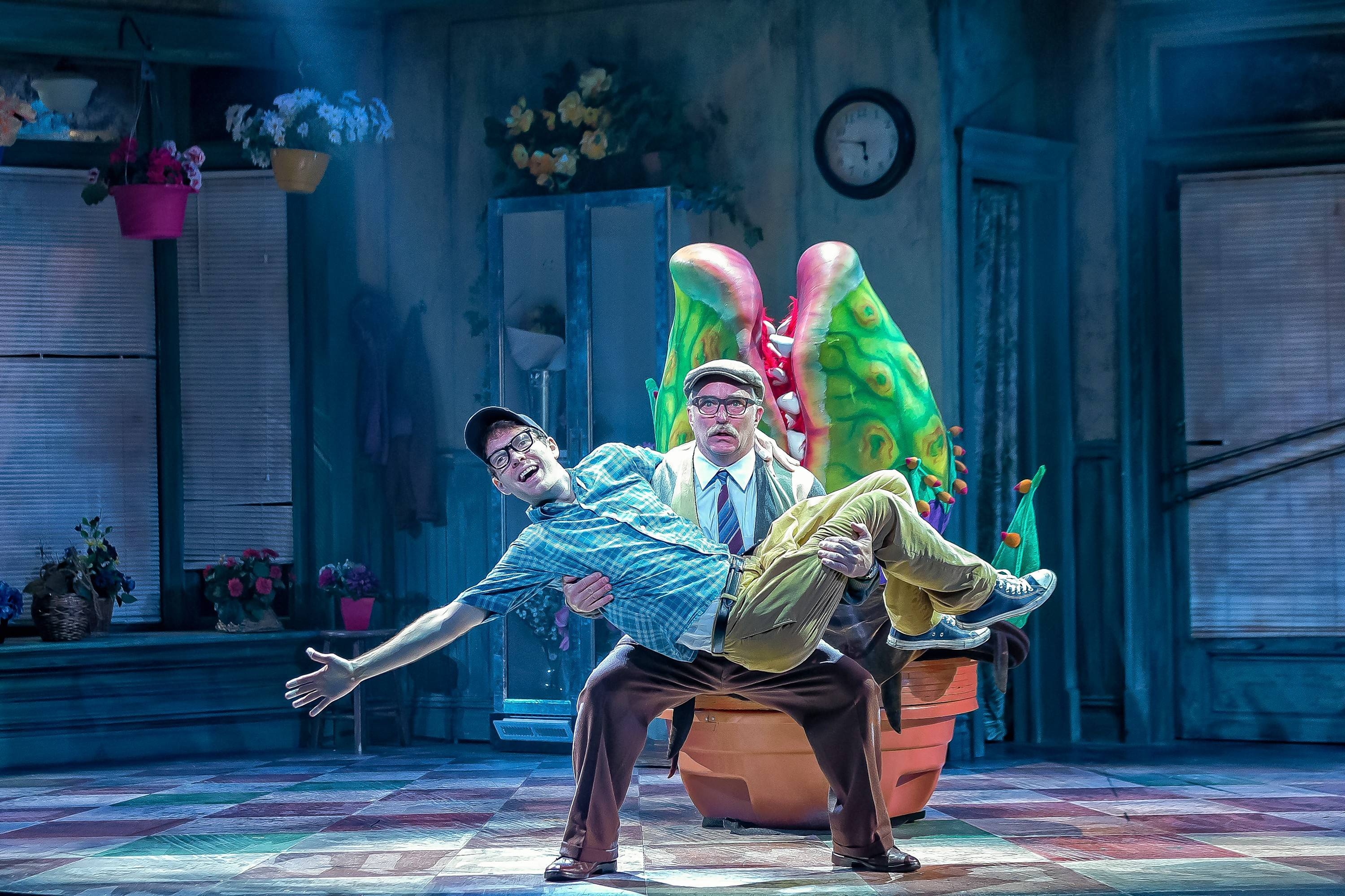 "Mr. Mushnik (Ron E. Rains) tries to convince Seymour (Will Lidke) to stay in Skid Row despite his newfound fame in ""Little Shop of Horrors"" at Drury Lane Theatre in Oakbrook Terrace."