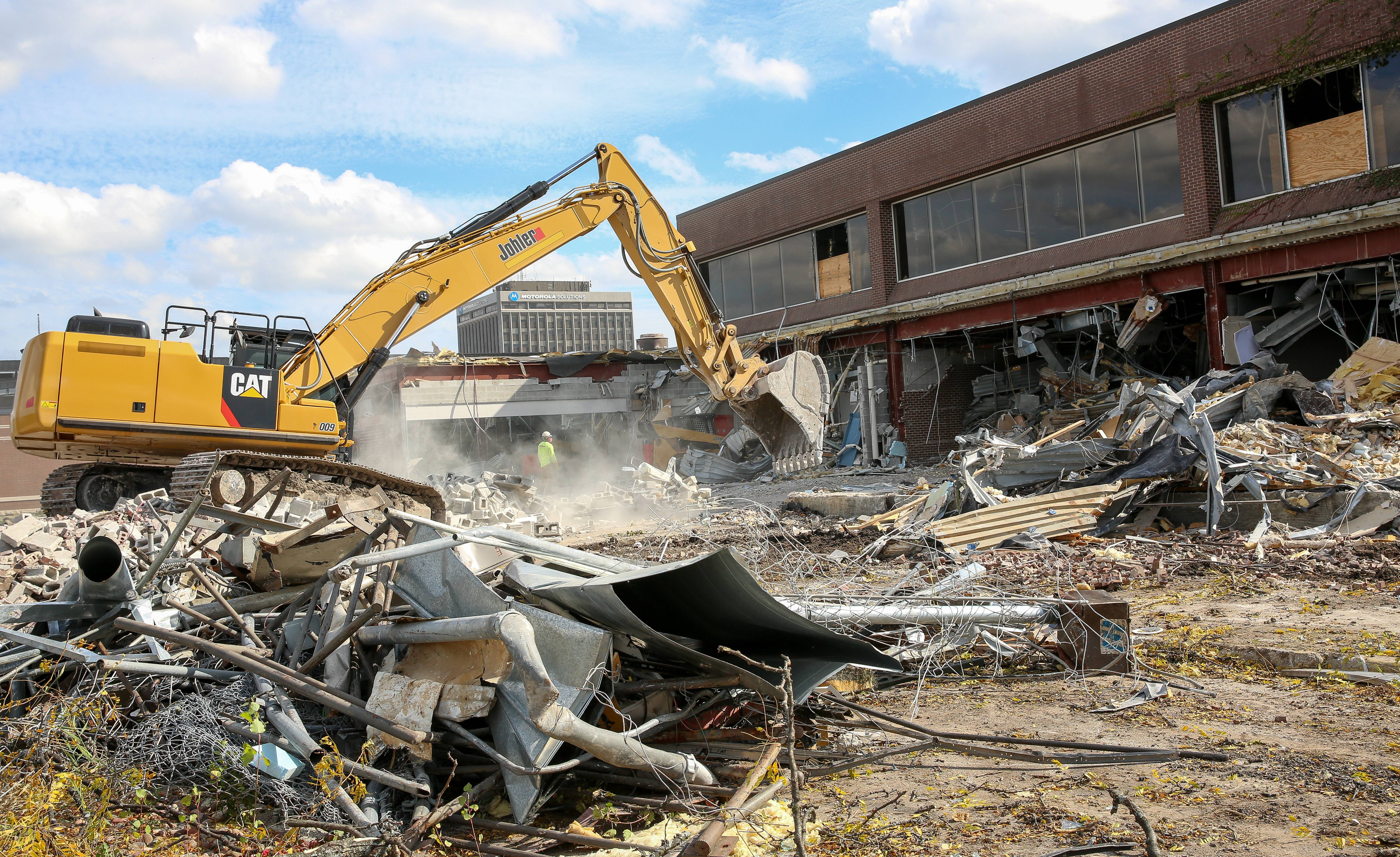 Demolition of the Galvin Center -- where Motorola Solutions once had its company museum, training center and client interaction -- continues Wednesday. It is the first major Motorola building to be razed as part of a massive redevelopment of the 260-acre former corporate campus.