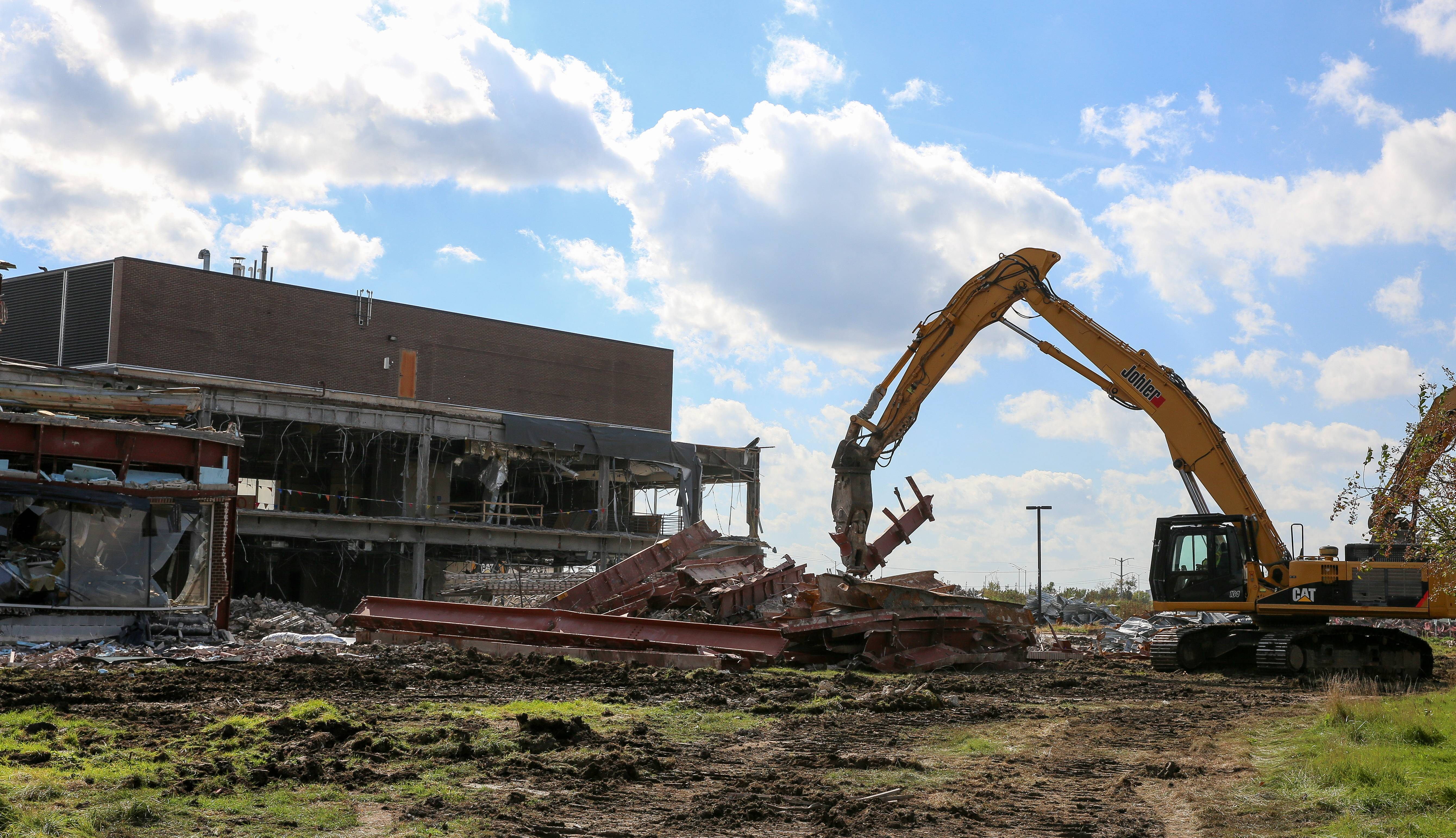 Workers demolish Motorola Solutions' former Galvin Center in Schaumburg to make way for an already approved Topgolf entertainment venue nearby and other future buildings on 225 acres of the onetime corporate campus.