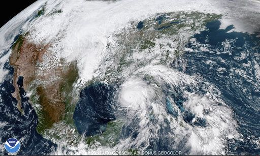 Hurricane Michael, center, in the Gulf of Mexico at 3:17 p.m. EDT Tuesday, Oct. 9.