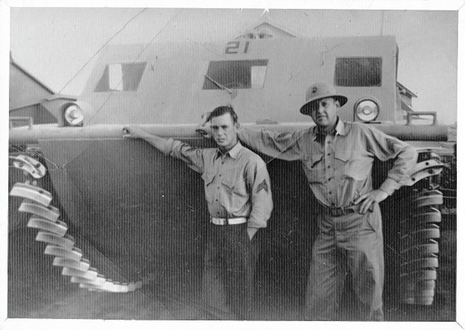 "In this photo taken shortly before his death, Marine Sgt. Harry A. ""Bud"" Carlsen, right, poses alongside a fellow Marine believed to be his best friend, Burr Wilton Robbins. Carlsen died charging a Japanese machine gun nest."
