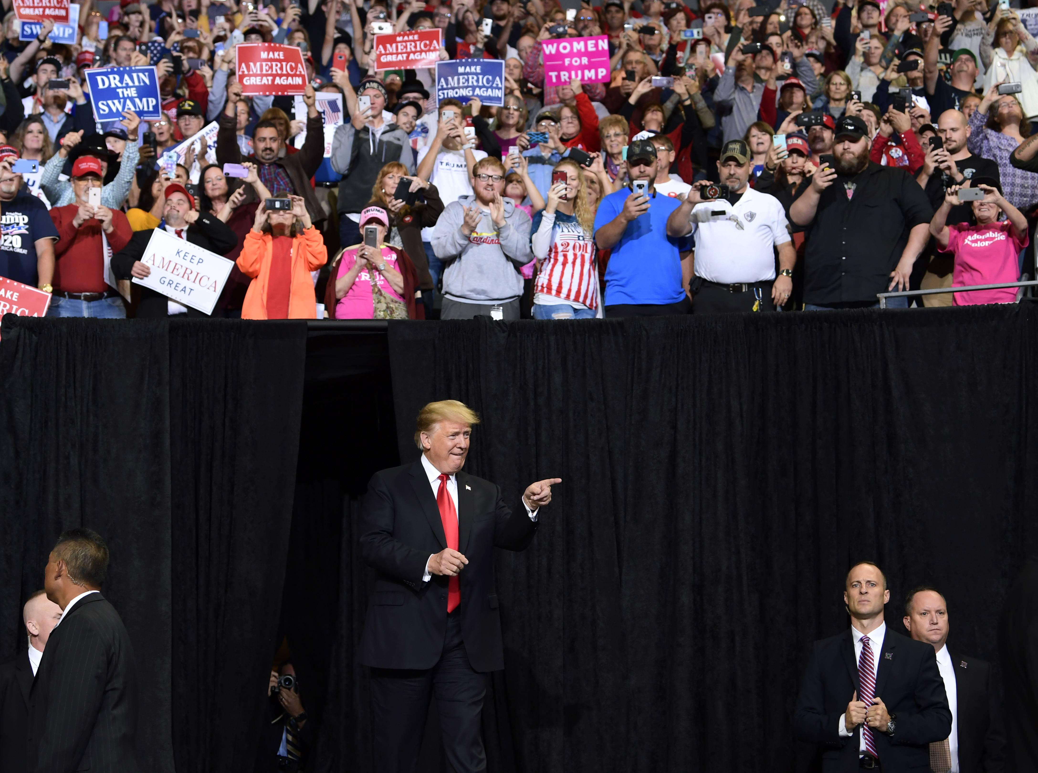 President Donald Trump arrives to speak at a rally in Council Bluffs, Iowa, Tuesday, Oct. 9, 2018.