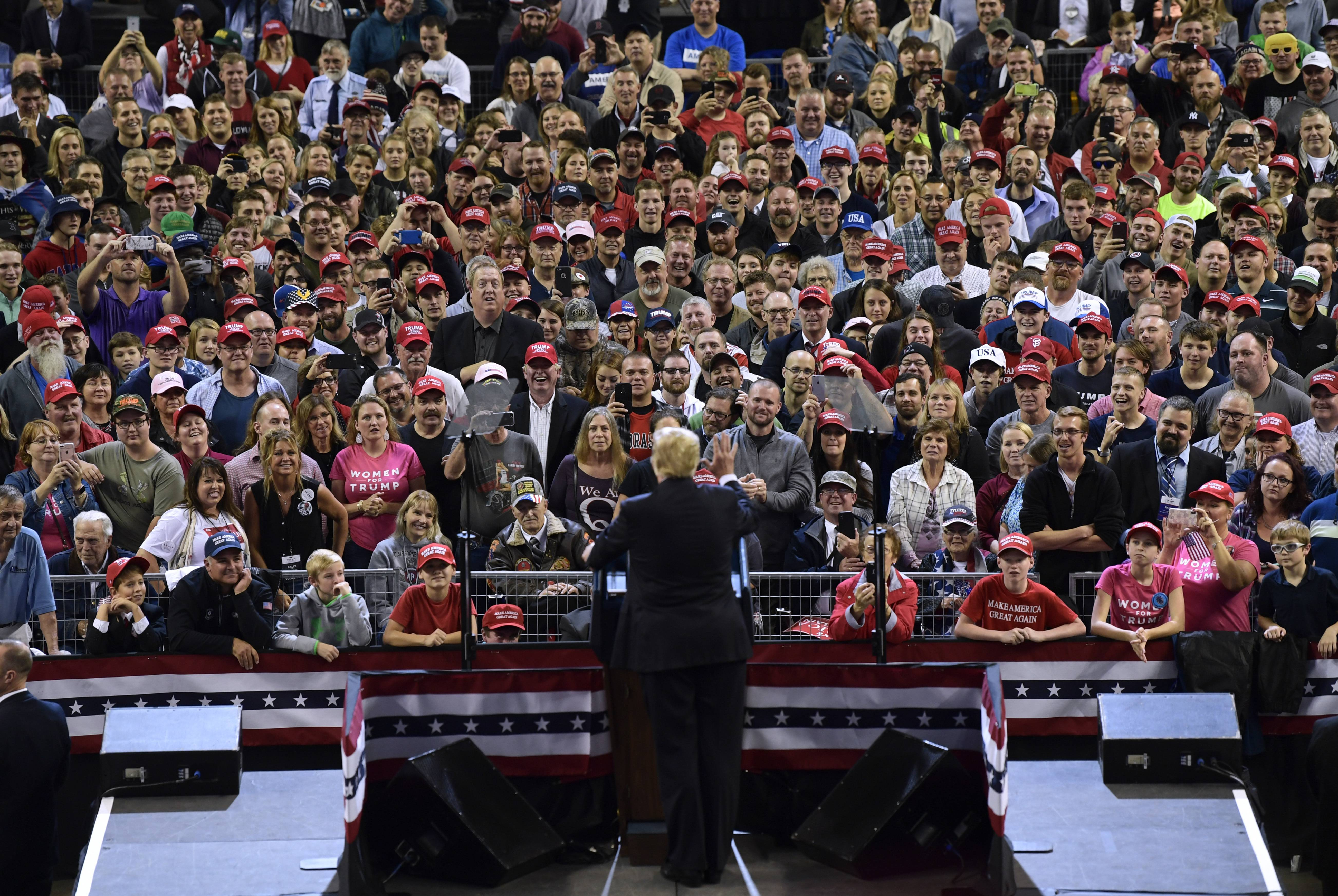 President Donald Trump speaks at a rally in Council Bluffs, Iowa, Tuesday, Oct. 9, 2018.