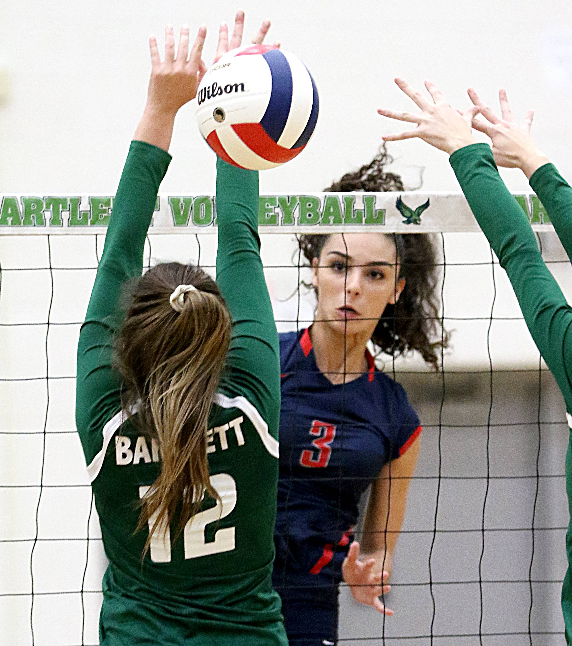 South Elgin's Angelina Negron puts down a kill.