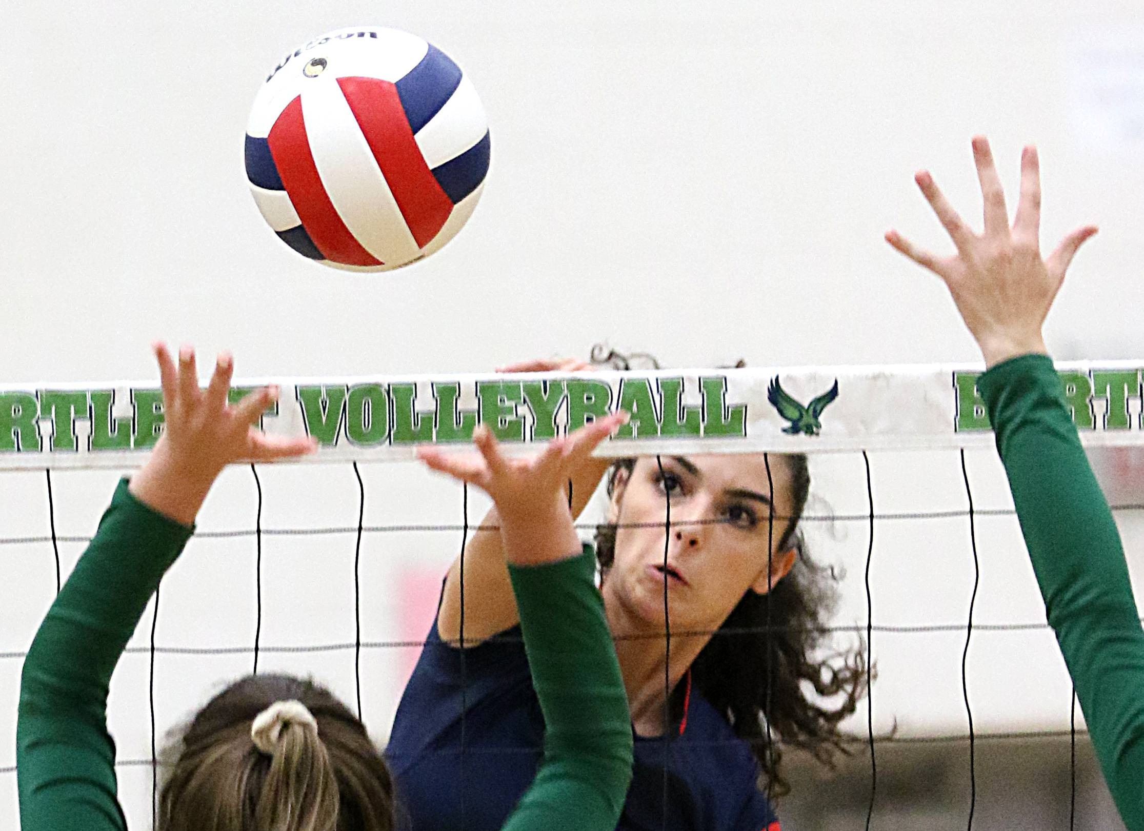 South Elgin's Angelina Negron sends the ball over the net during varsity girls volleyball at Bartlett on Wednesday evening.