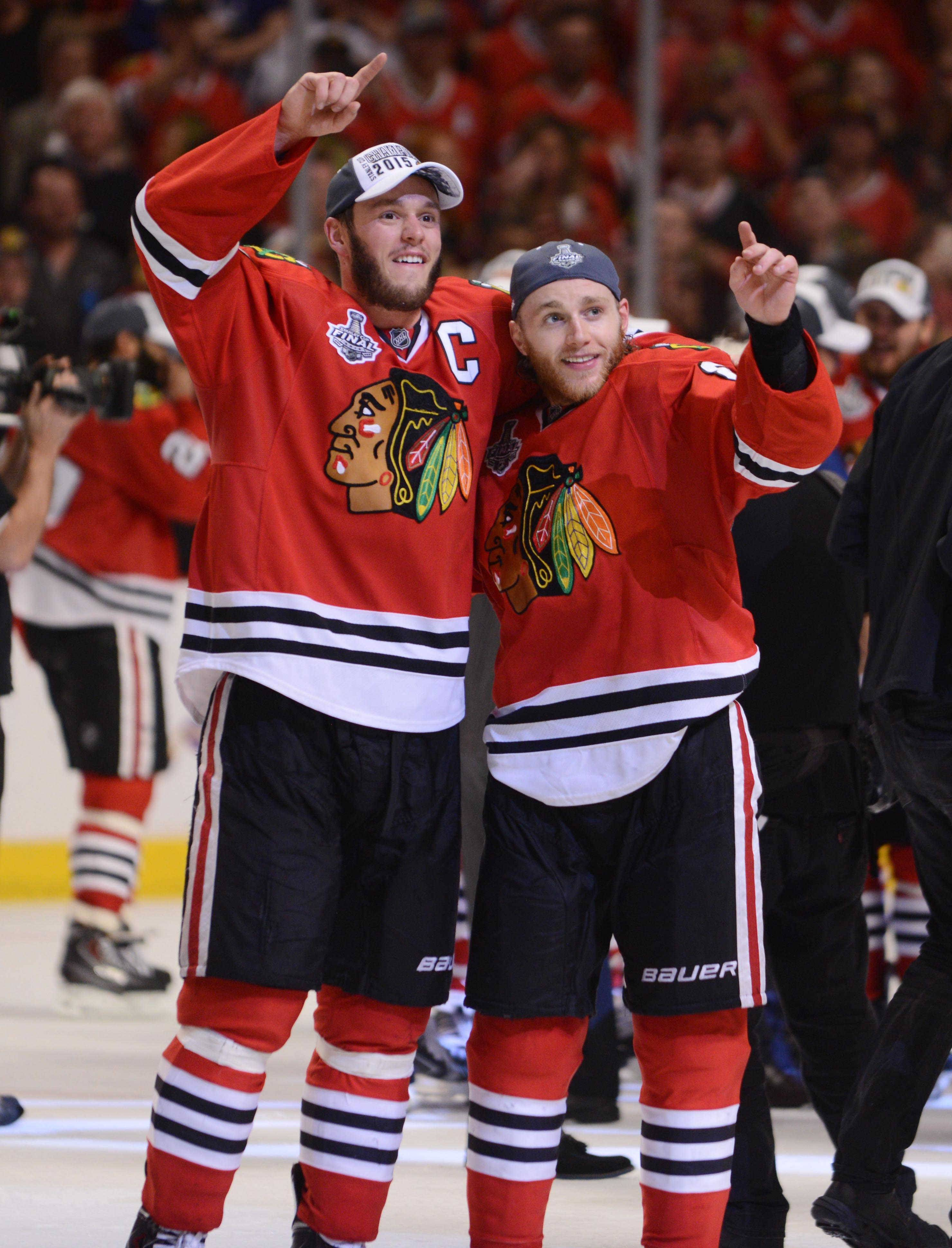Captain Jonathan Toews and Patrick Kane salute the fans after winning the Stanley Cup against Tampa Bay in Game 6 June 15, 2015, at the United Center.