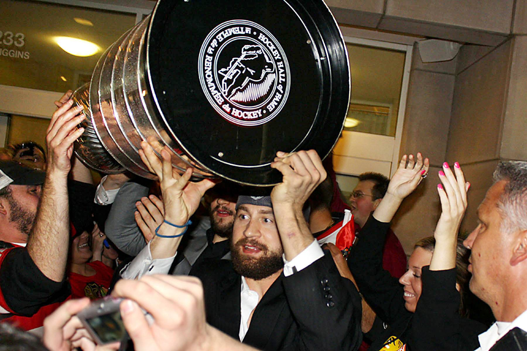 Adam Burish carries the Stanley Cup in 2010 at Harry Caray's Italian Steakhouse in Rosemont.