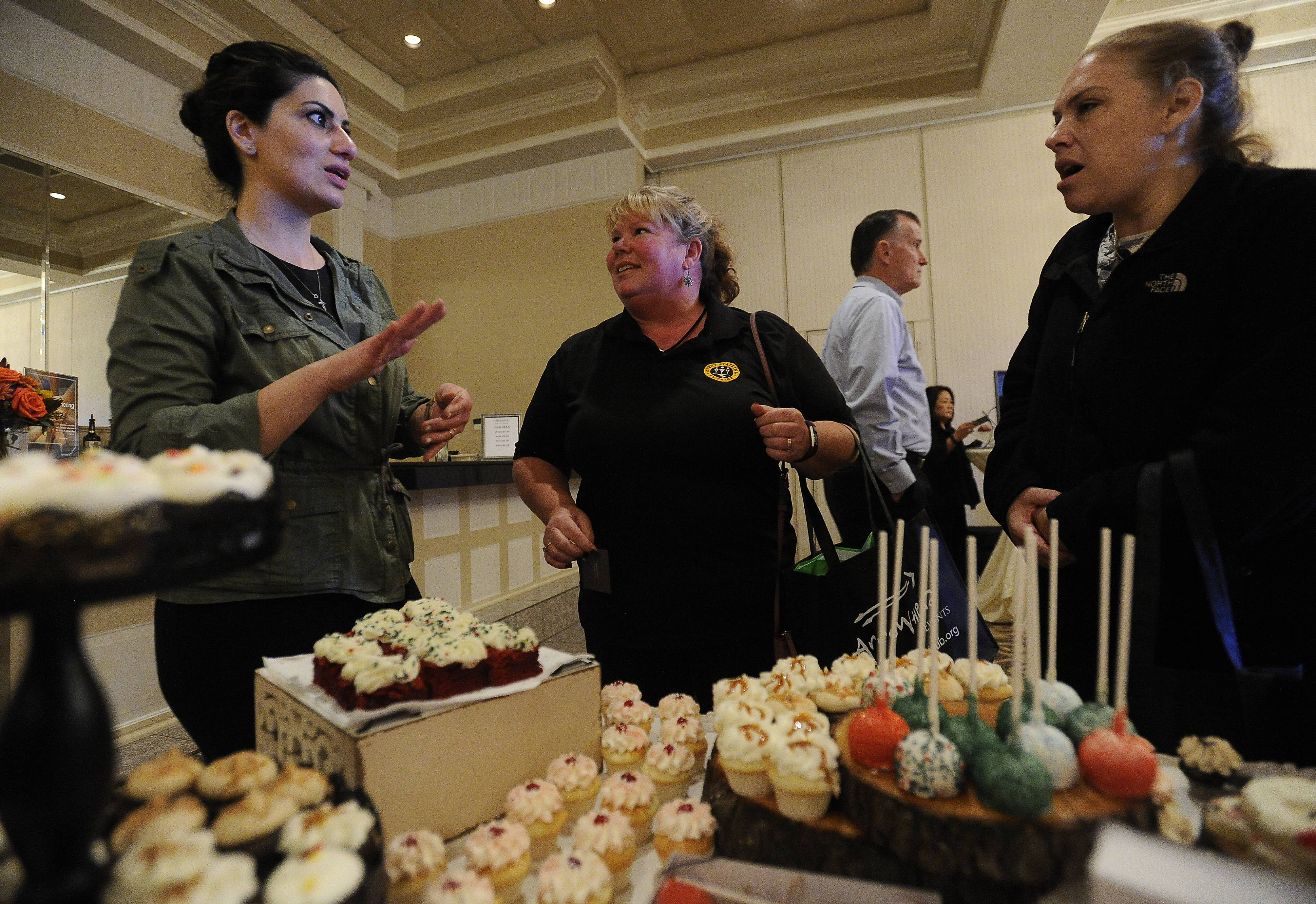 Paige Logan of Lombard, center, with her friend Jennifer Freymark of Glen Ellyn and Norma Samaan, left, from The Vanilla Sugar Bakery of Winfield took part in the Daily Herald Business Ledger's DuPage Hospitality Expo Thursday.