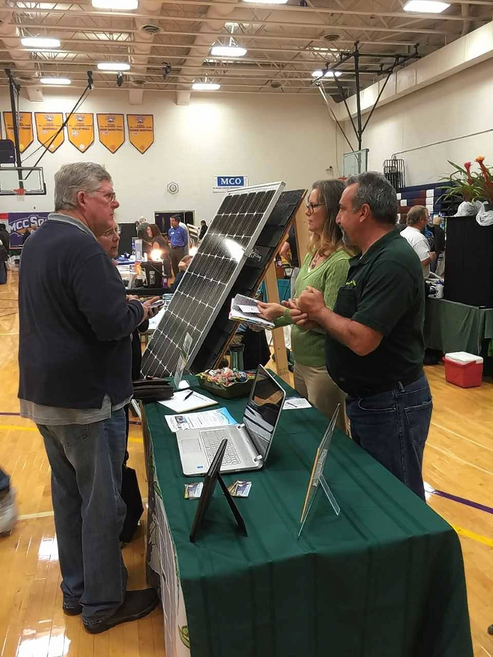Paul LaBarbera, right, president of Magitek Energy Solutions, talks about solar panels with attendees of McHenry County College's annual Green Living Expo. This year's expo on Nov. 3 will feature some of the same vendors and also focus more on agriculture.