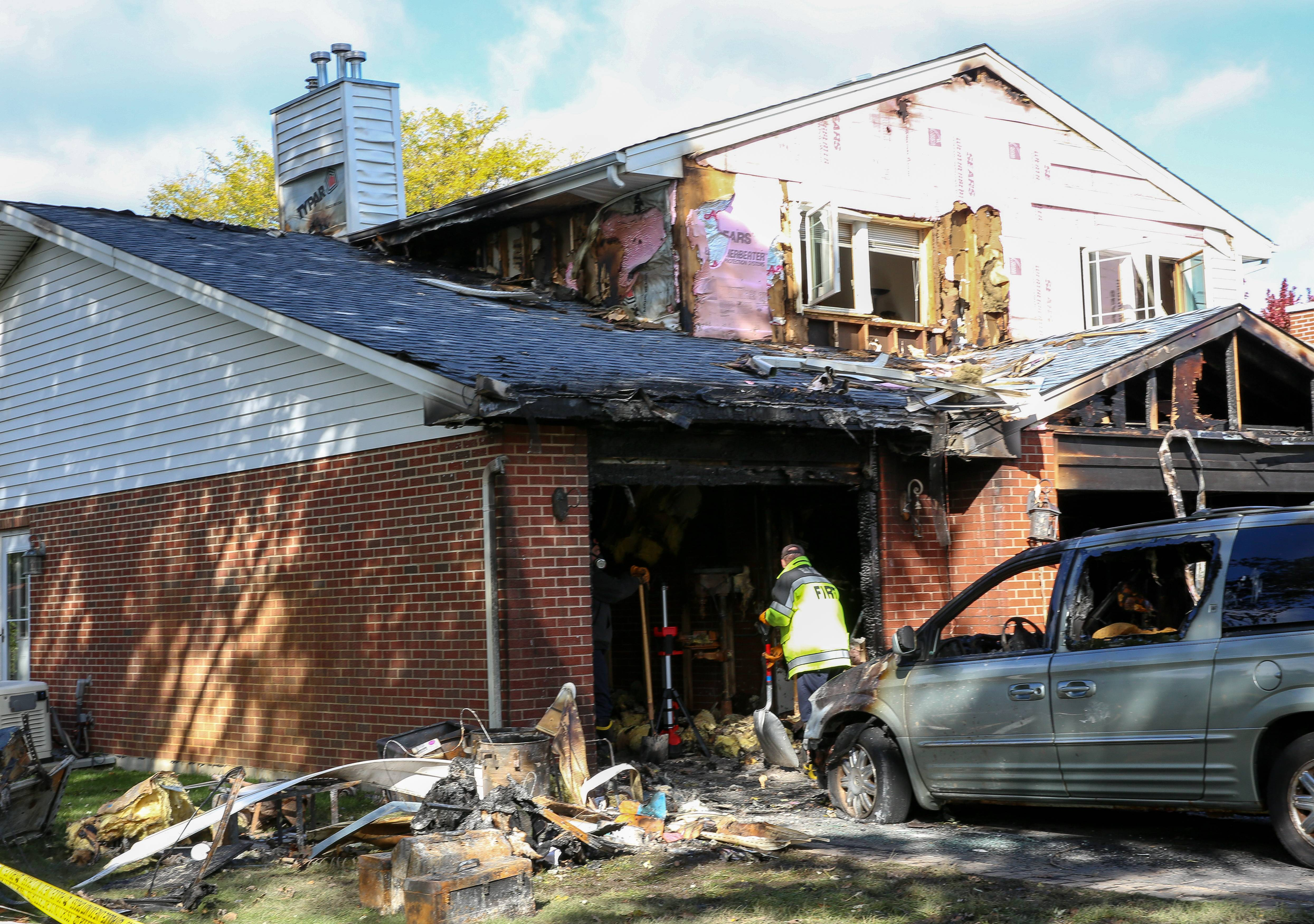 Firefighters searched Thursday through remains of a house fire in the 500 block of Crest Avenue in Elk Grove Village. The cause of the fire remained undetermined Thursday.
