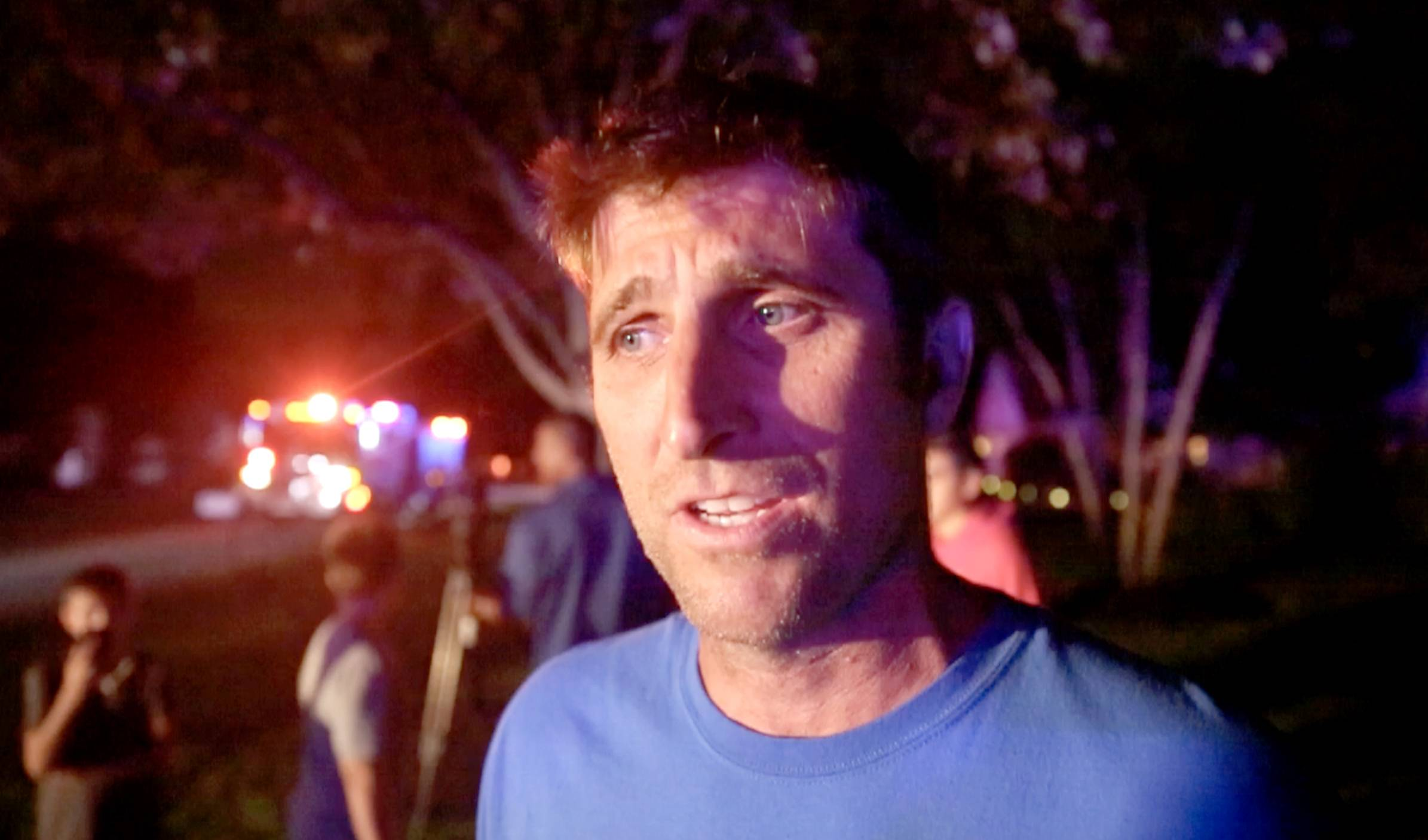 Brett Tanner of Elk Grove Village describes how he and neighbor Jim McEnroe helped rescue the people inside a burning home on Crest Avenue Wednesday night.