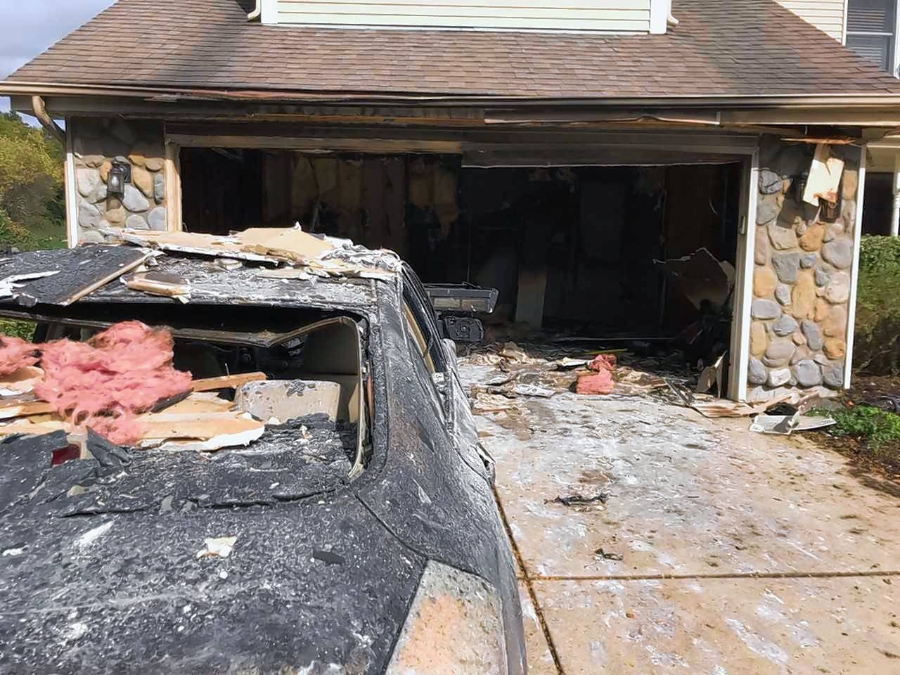A cigarette is being blamed for a West Dundee garage fire Thursday that destroyed a car and caused about $50,000 in damage.