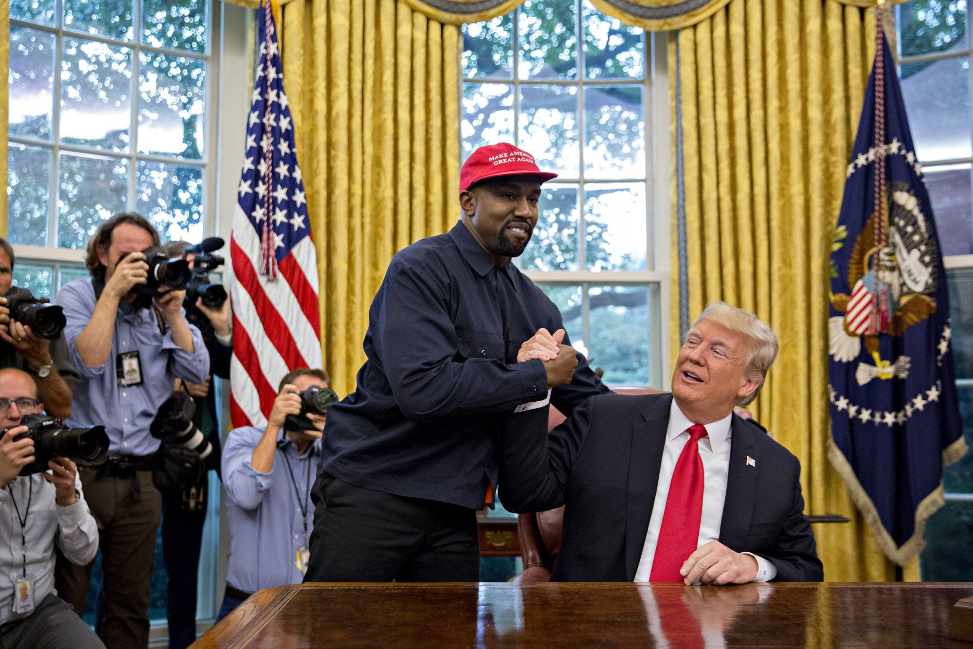 Rapper Kanye West shakes hands with President Donald Trump Thursday during a meeting in the Oval Office in the White House.