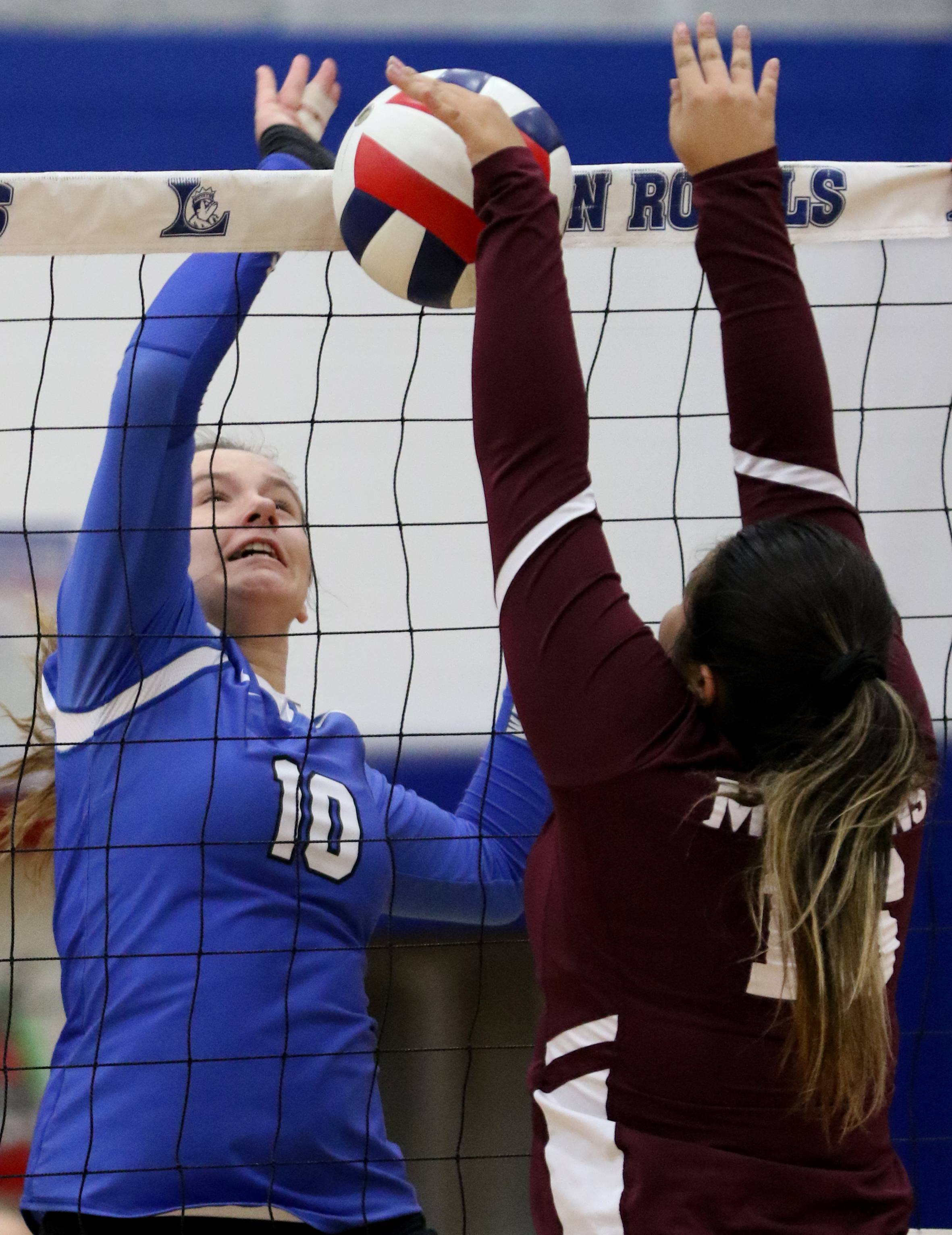Larkin's Ashley Miller, left, battles Elgin's Caitlyn Keith at the net.