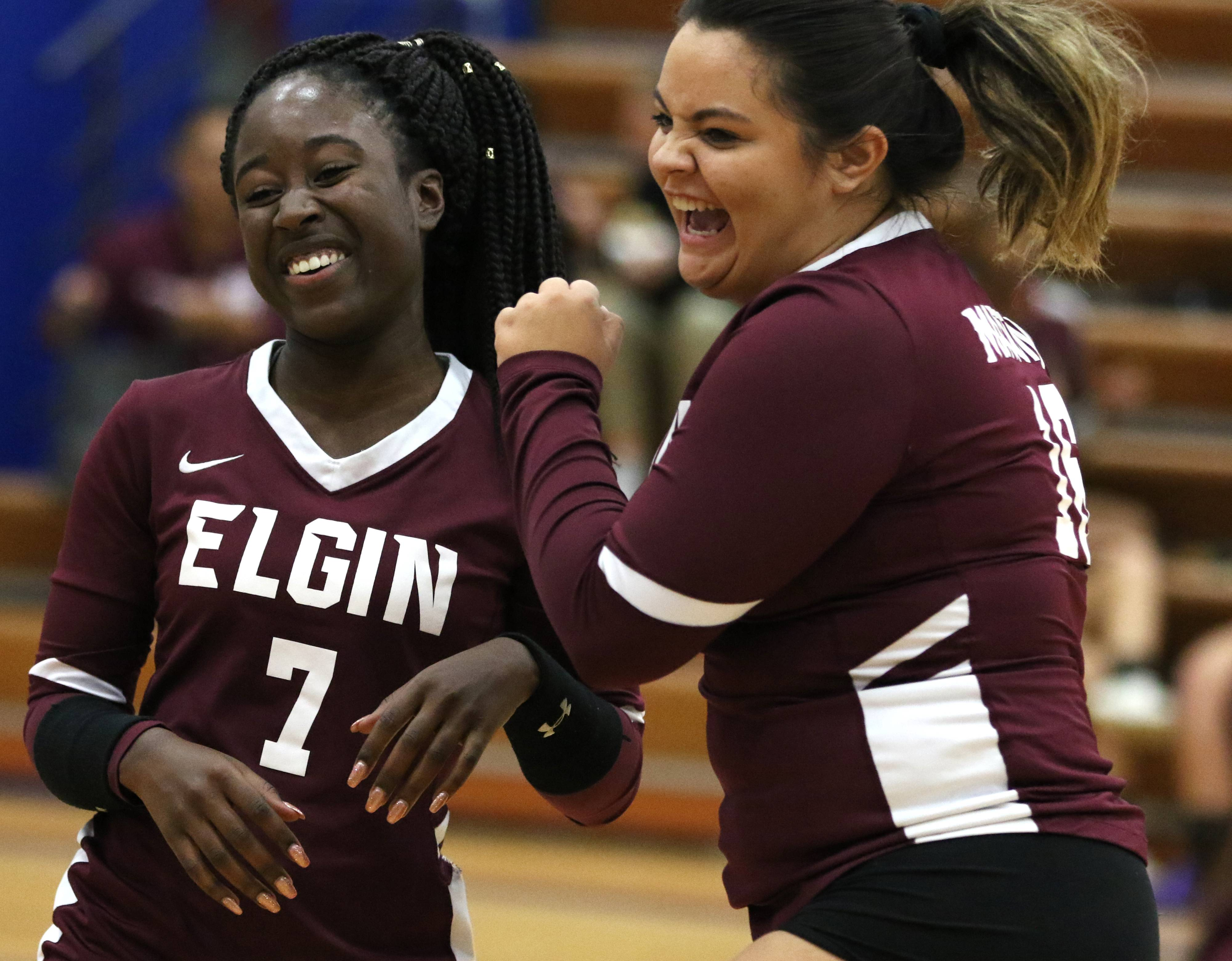 Elgin's Kierra Turpin, left, and Caitlyn Keith are all smiles after winning the first set in varsity girls volleyball at Larkin on Wednesday.