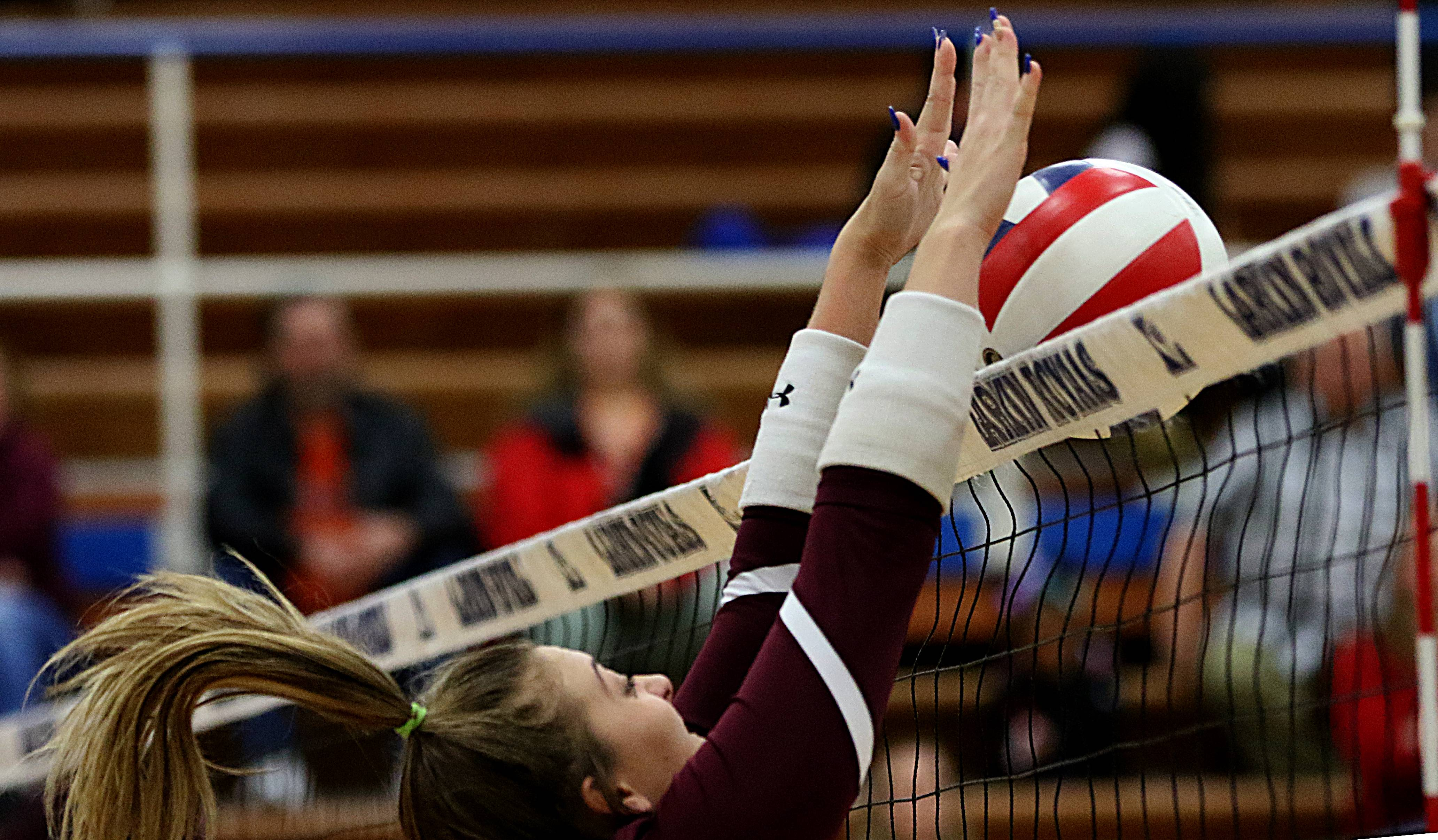 Elgin's Inga Suceska blocks the ball in varsity girls volleyball at Larkin on Wednesday.