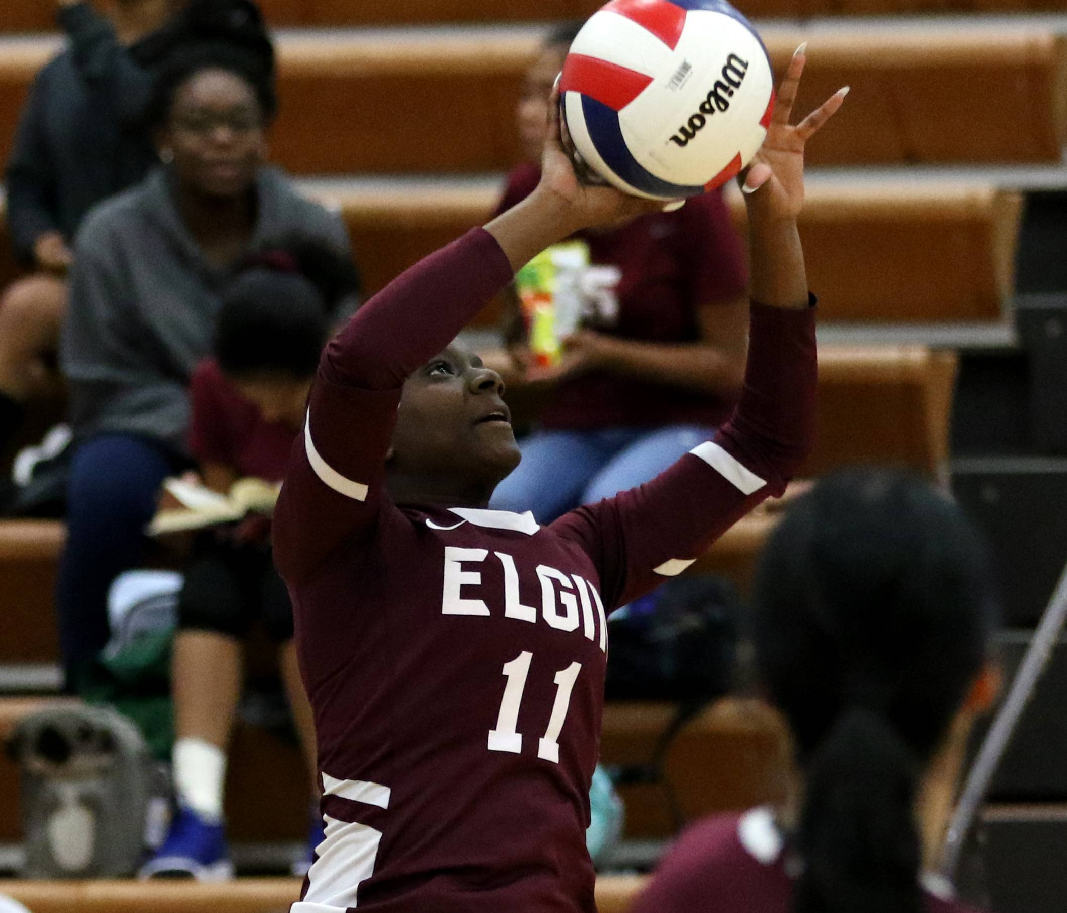 Elgin's TeKena Lindsay sets the ball in varsity girls volleyball at Larkin on Wednesday.