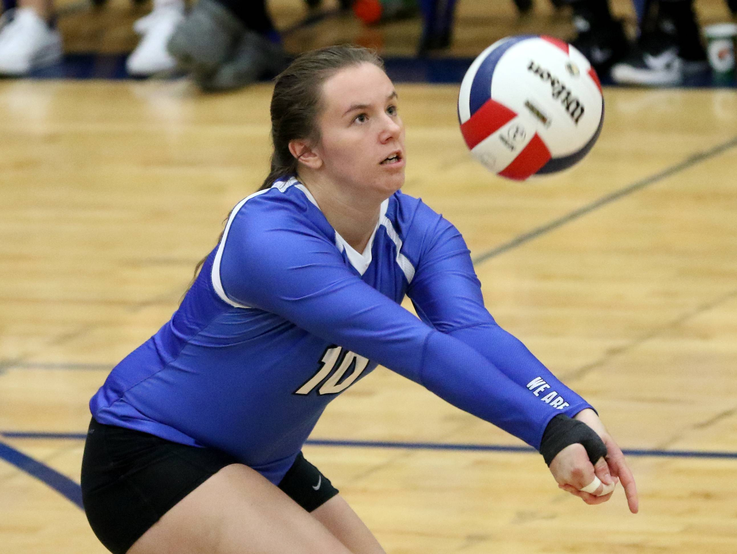 Larkin's Ashley Miller passes the ball against Elgin in varsity girls volleyball at Larkin on Wednesday.