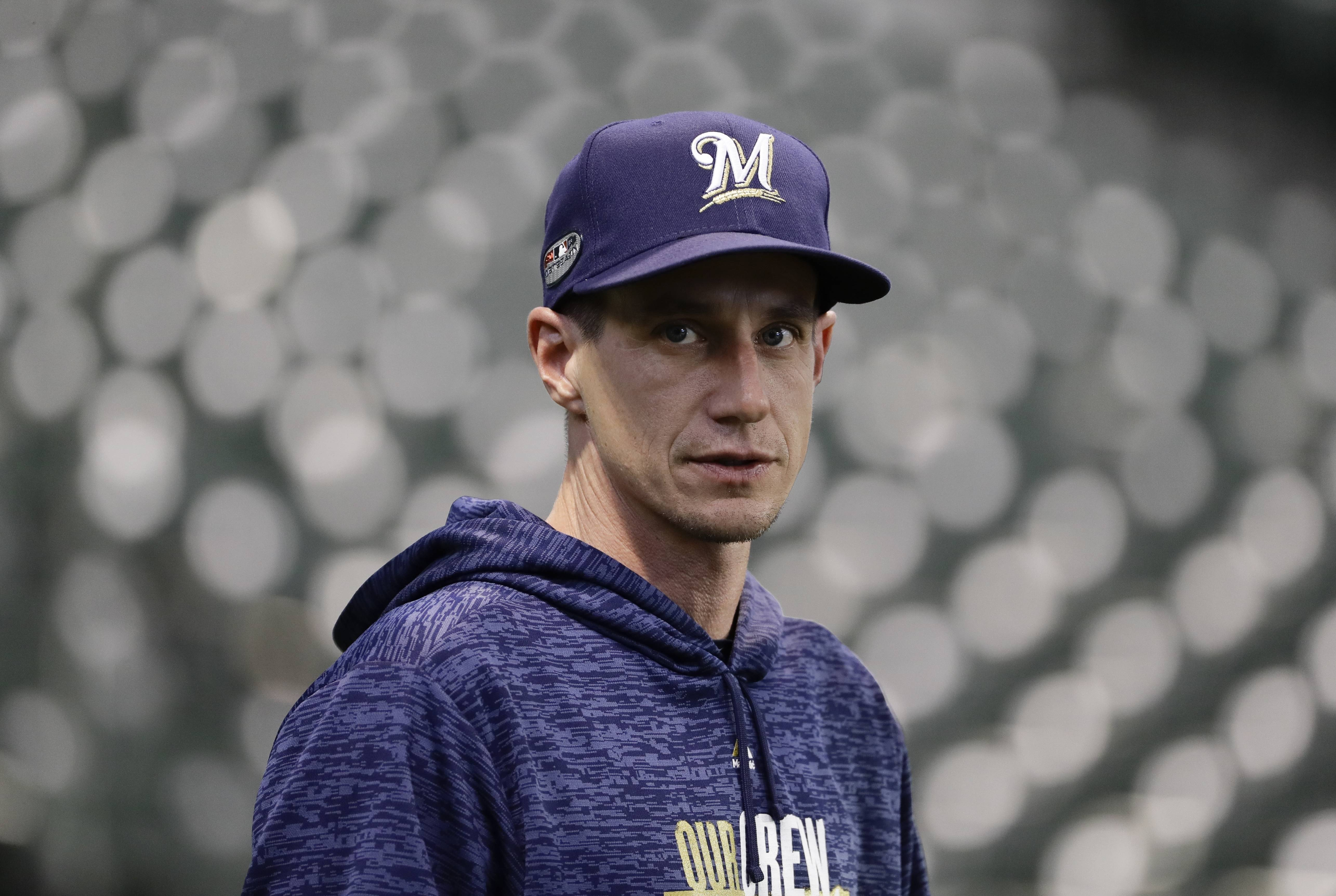 Brewers manager Craig Counsell takes in batting practice Wednesday in Milwaukee.
