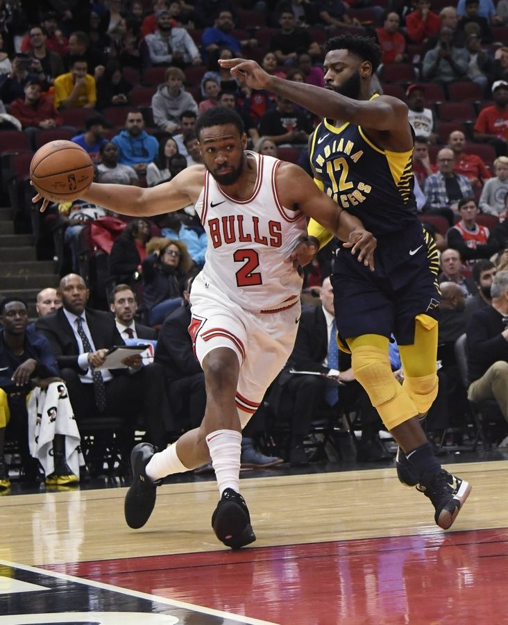Chicago Bulls' Jabari Parker (2) drives to the basket as Indiana Pacers' Tyreke Evans (12) defends him during the second half of an NBA preseason basketball game Wednesday, Oct. 10, 2018, in Chicago.