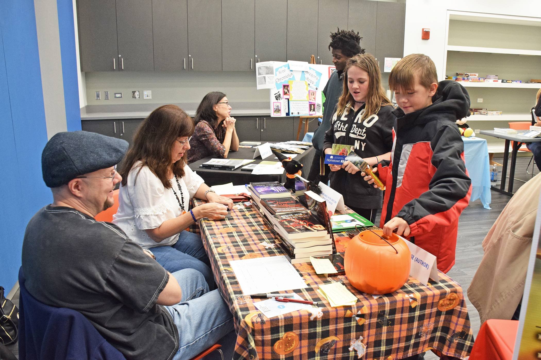 Authors greet children at the 2017 Indie Author Day at the Schaumburg Library. This year's event will take place this Saturday, Oct. 13, from 11 a.m. to 2 p.m. Books for all ages in many genres will be a available for purchase and signing. Susan Miura