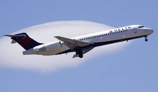 FILE- In this May 24, 2018, file photo a Delta Air Lines passenger jet plane, a Boeing 717-200 model, approaches Logan Airport in Boston. Delta Air Lines Inc. (DAL) on Thursday, Oct. 11, 2018, reported third-quarter earnings of $1.31 billion.
