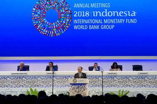 World Bank President Jim Yong Kim, foreground, delivers his speech during the opening of International Monetary Fund (IMF) World Bank annual meetings in Bali, Indonesia on Friday, Oct. 12, 2018.