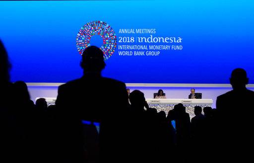 World Bank President Jim Yong Kim, right, attends the opening of International Monetary Fund (IMF) World Bank annual meetings in Bali, Indonesia on Friday, Oct. 12, 2018.