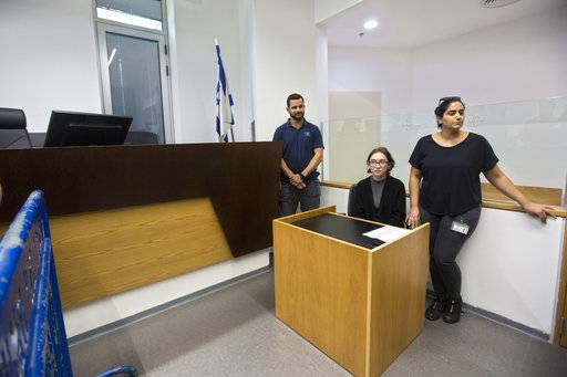 American Lara Alqasem, center, sits in a courtroom prior to a hearing at the district court in Tel Aviv, Israel, Thursday, Oct. 11, 2018. A senior Israeli cabinet minister on Wednesday defended the government's handling of the case of an American graduate student held in detention at the country's international airport for the past week over allegations that she promotes a boycott against the Jewish state.