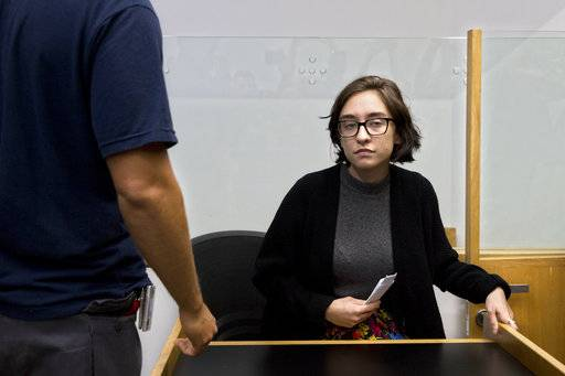 American Lara Alqasem sits in a courtroom prior to a hearing at the district court in Tel Aviv, Israel, Thursday, Oct. 11, 2018. A senior Israeli cabinet minister on Wednesday defended the government's handling of the case of an American graduate student held in detention at the country's international airport for the past week over allegations that she promotes a boycott against the Jewish state.