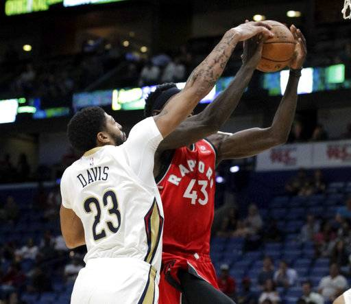 New Orleans Pelicans forward Anthony Davis (23) blocks a shot by Toronto Raptors forward Pascal Siakam (43) during the first half of a preseason NBA basketball game in New Orleans, Thursday, Oct. 11, 2018.