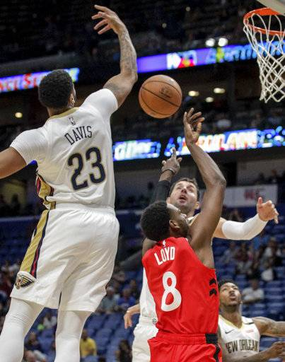 New Orleans Pelicans forward Anthony Davis (23) blocks a shot by Toronto Raptors guard Jordan Loyd (8) during the first half of a preseason NBA basketball game in New Orleans, Thursday, Oct. 11, 2018.