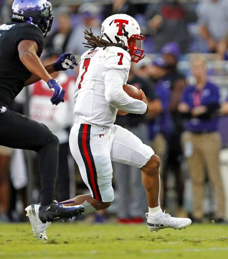 Texas Tech's Jett Duffey (7) runs downfield with the ball during the first half of an NCAA college football game against TCU, Thursday, Oct. 11, 2018, in Fort Worth, Texas. (Brad Tollefson/Lubbock Avalanche-Journal via AP)