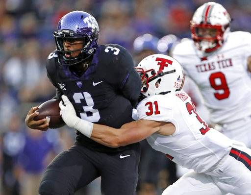 Texas Tech's Justus Parker (31) forces a fumble on TCU's Shawn Robinson (3) during the first half of an NCAA college football game Thursday, Oct. 11, 2018, in Fort Worth, Texas. (Brad Tollefson/Lubbock Avalanche-Journal via AP)