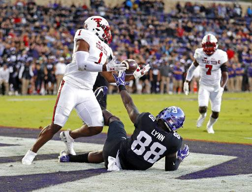 Texas Tech's Jordyn Brooks (1) intercepts a pass next to TCU's Artayvious Lynn (88) during the first half of an NCAA college football game Thursday, Oct. 11, 2018, in Fort Worth, Texas. (Brad Tollefson/Lubbock Avalanche-Journal via AP)