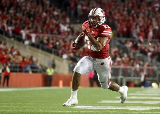 FILE - In this Saturday, Oct. 6, 2018, file photo, Wisconsin's Jonathan Taylor runs for a touchdown during the second half of an NCAA college football game against Nebraska in Madison, Wis. The Badgers need consistent production from Taylor at the Big House.