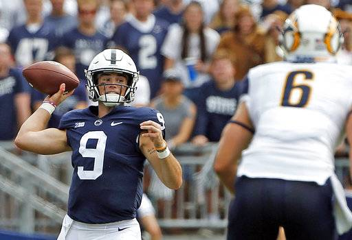FILE - In this Saturday, Sept. 15, 2018, file photo, Penn State quarterback Trace McSorley (9) throws a pass against Kent State during the first half of an NCAA college football game in State College, Pa. McSorley has thrown for a total of 757 yards and seven touchdowns in his last two games against the Spartans, and the spotlight will be on him again because Michigan State famously stuffs the run but can't stop the pass.