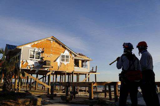 A home stands damaged from hurricane Michael as members of a South Florida urban search and rescue team look for survivors in Mexico Beach, Fla., Friday, Oct. 12, 2018.
