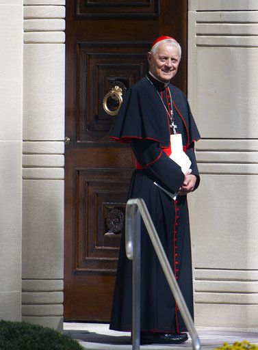 FILE - In this Wednesday, Sept. 23, 2015 file photo Cardinal Donald Wuerl, archbishop of Washington, stands in the doorway of the Apostolic Nunciature, the Vatican's diplomatic mission in Washington. Pope Francis has accepted Friday Oct. 12, 2108 the resignation of Washington Cardinal Donald Wuerl after he became entangled in two major sexual abuse and cover-up scandals and lost the support of many in his flock.