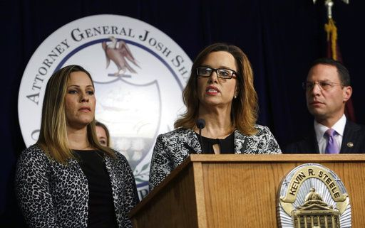Patty Fortney, center, and Carolyn Fortney, left, Harrisburg-area clergy abuse victims, participate in a news conference alongside Pennsylvania Attorney General Josh Shapiro Friday Oct. 12, 2018 in Norristown, Pa. Shapiro is appealing to legislators to change state law so that civil cases can be pursued in court in decades-old clergy abuse cases. Shapiro also wants the Legislature to lift the statute of limitations for criminal prosecutions going forward.