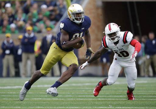 "FILE - In this Sept. 8, 2018, file photo, Notre Dame wide receiver Miles Boykin (81) runs with the ball against Ball State during the second half of an NCAA college football game in South Bend, Ind. Notre Dame won 24-16. Boykin is usually the tallest guy in a classroom at Notre Dame. The Irish offensive huddle is another matter. ""Once we had Chase (Claypool), Cole (Kmet), Alizé (Mack) and me, and I'm the smallest receiver out there on the field,� said the 6-foot-4, 228-pound senior wideout, one of the shortest of six Notre Dame receivers and tight ends. Notre Dame plays Pittsburgh this week."