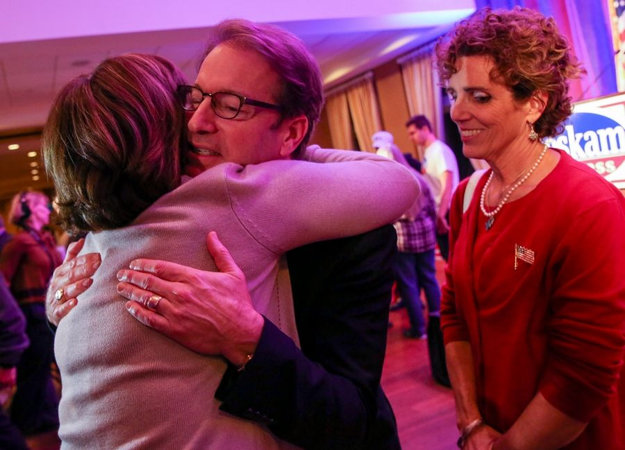 Republican U.S. Rep. Peter Roskam, whose 6th District seat once was held by legendary conservative Henry Hyde, gets a hug from a supporter, with wife Elizabeth, right, after conceding to Democrat Sean Casten on Tuesday.