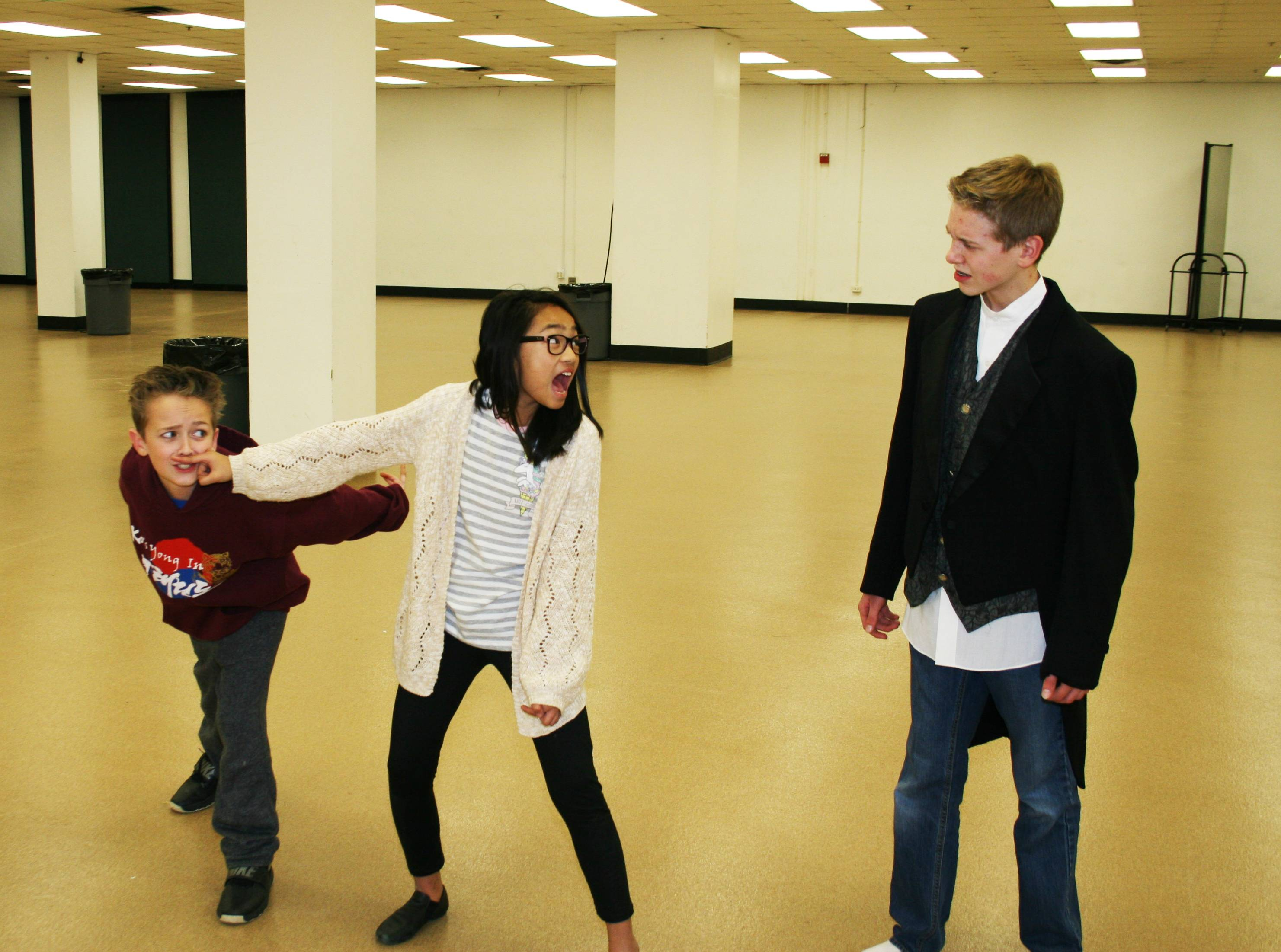 "From left are Jack (Will Zimmerman), Annie (Auren Briones) and Mr. Dickens (Nathan Shue) from Children's Theatre of Elgin's production of ""A Ghost Tale for Mr. Dickens Jr."""