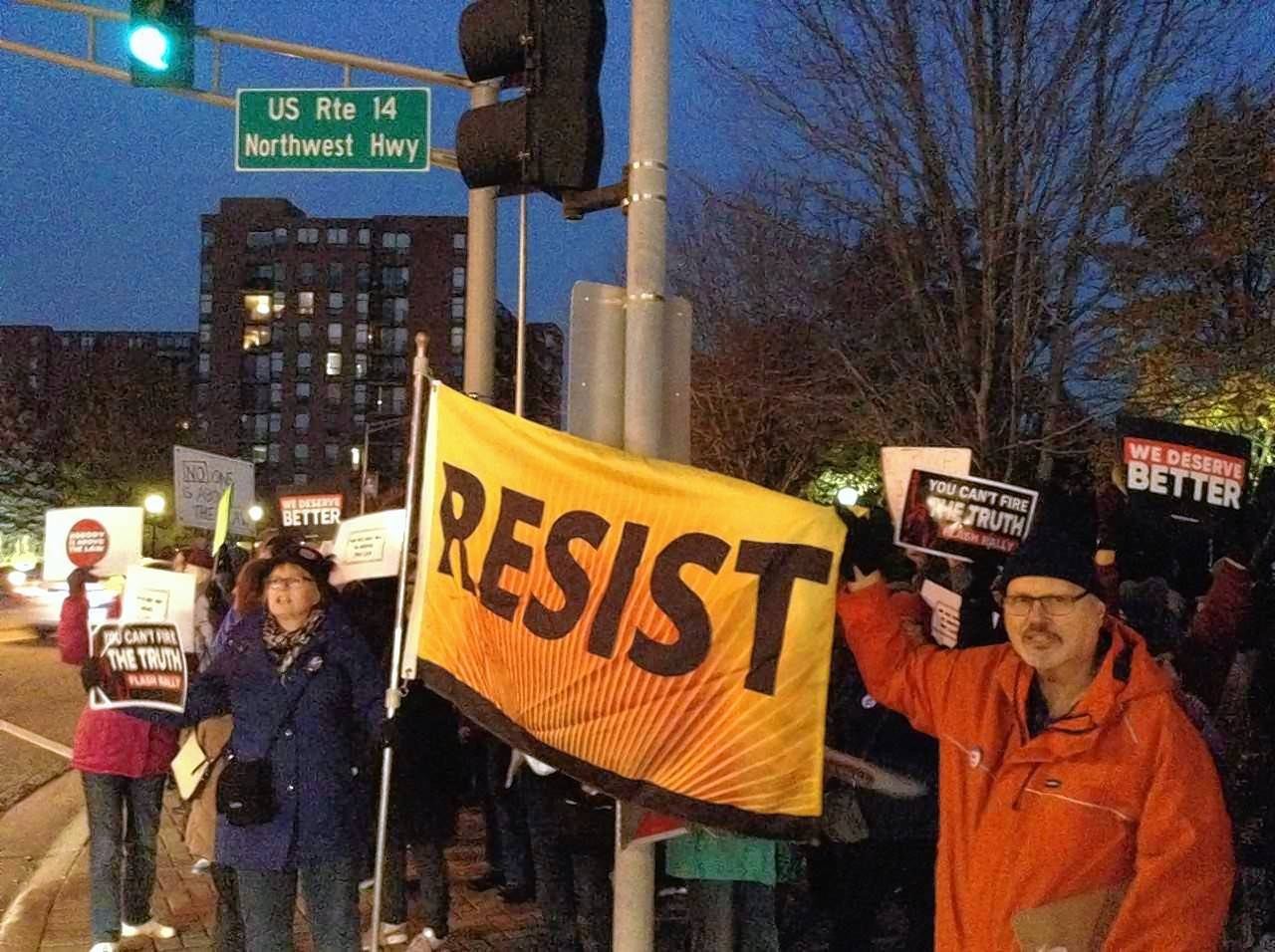 Protesters rallied Thursday night at the corner of Arlington Heights Road and Northwest Highway in Arlington Heights in support of the investigation by Special Counsel Robert Mueller into Russian meddling in the 2016 election.