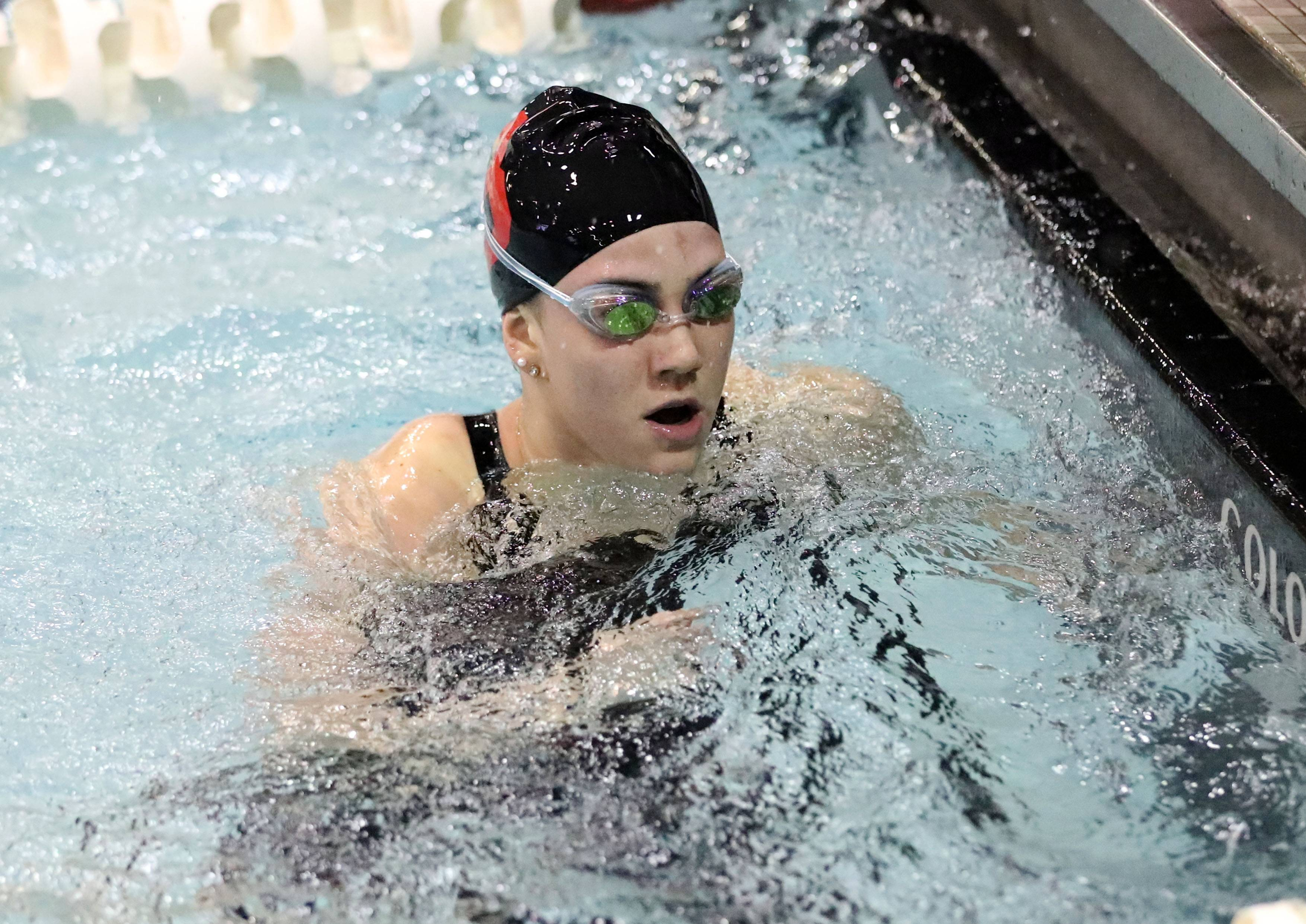 Barrington's Ally Penrod finishes the 100-yard freestyle during the girls state swimming meet last season.