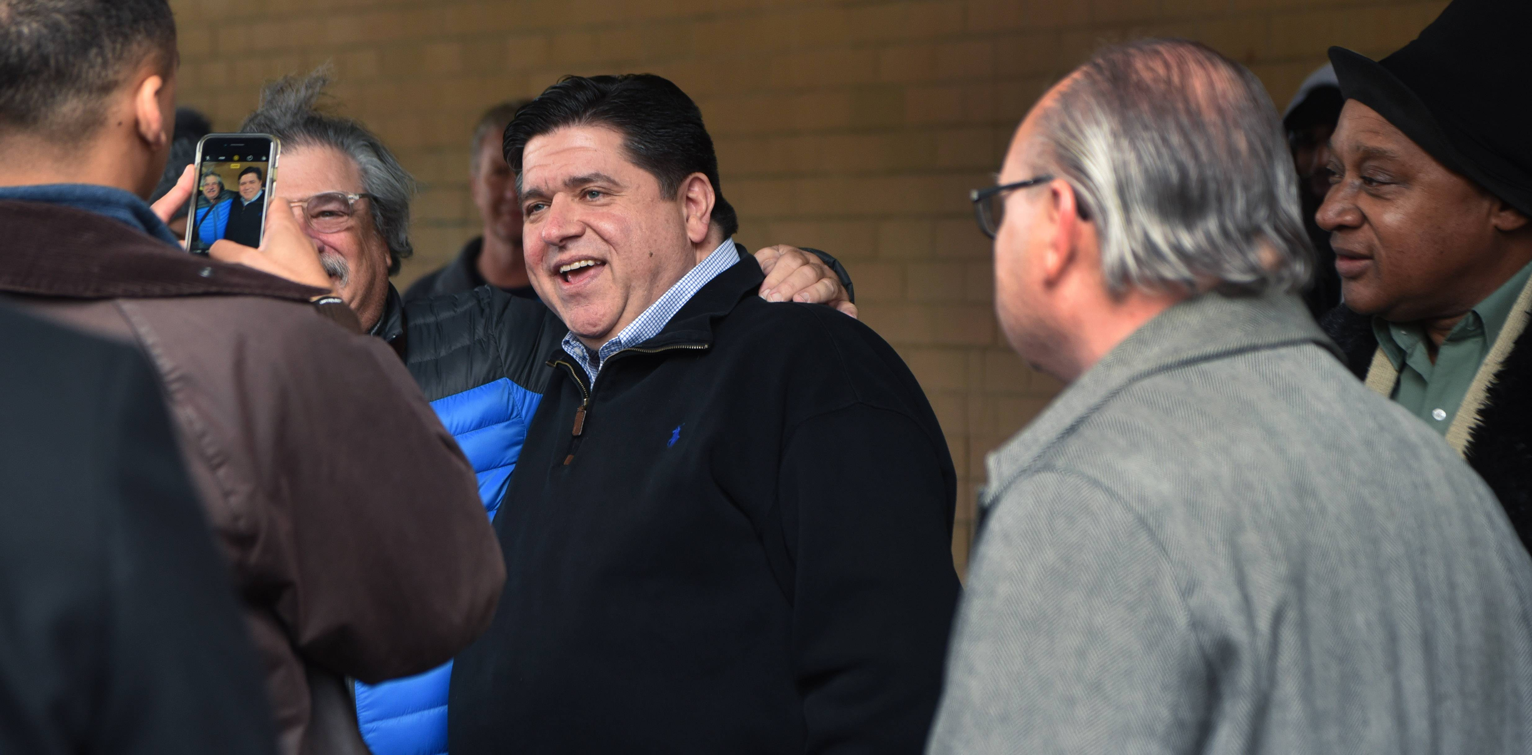 Gov.-elect J.B. Pritzker greets supporters during a visit to the CTA Roosevelt Station at State Street and Roosevelt Road in Chicago Wednesday.